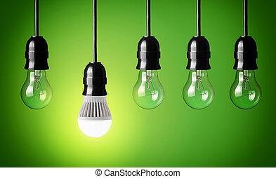 Glowing LED bulb and simple light bulbs