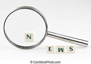 News word and magnifying glass