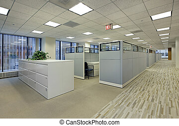 Office area with cubicles in high rise building