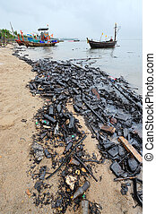 Oil spill. Contaminated Beach in Chonburi, Thailand.