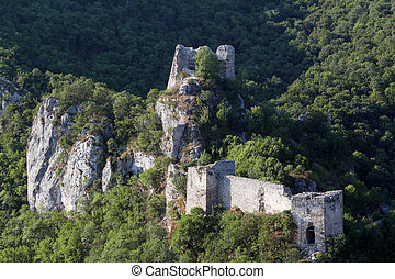 old ruined fortress on mountain landscape