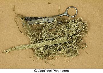 Old scissors, thread and scraps of cloth