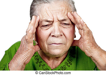 Old senior woman having migraine or headache