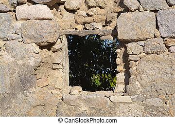 Old window of ruined home in Kefalos