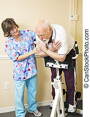Senior man struggles to do physical therapy for his back problems.