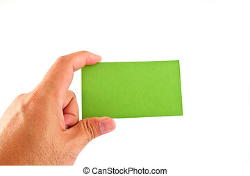 Paper green card in hand, isolated on white background