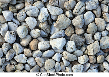 Pebble rocks in pastel colors, natural background.