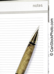 pen resting on a note page