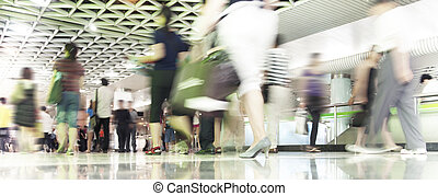 People in blurred motion