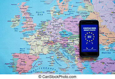 Phone with European Immunity passport app. Travel during Covid-19 concept.