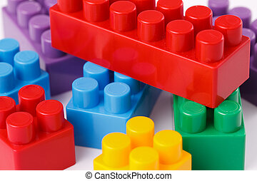 photo shot of plastic toy blocks on white background