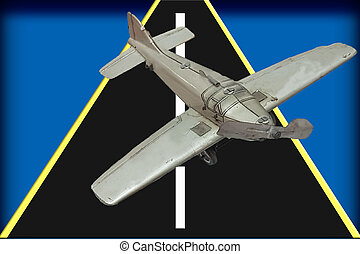 Picture of a retro gray metal toy airplane