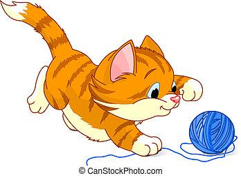 Kitten playing with yarn ball