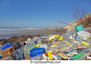 polluted beach with plastics and other floating objects