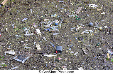 polluted river full of rubbish on the surface