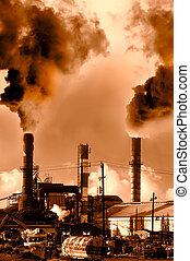 Menacing fumes arising from the smokestacks of an industrial plant