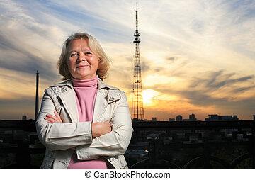 Portrait of a beautiful senior woman at sunset