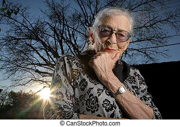 Portrait of a senior woman outdoors, thinking