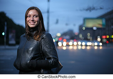 Portrait of a young woman at twilight