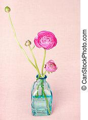 Ranunculus flowers in a vase on vintage background