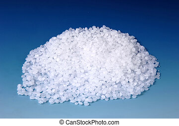 raw white plastic isolated at blue background