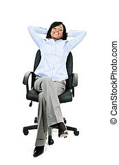 Relaxed businesswoman sitting on office chair
