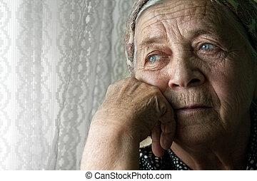 Sad lonely pensive old senior woman