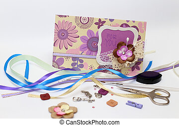 scrapbook. Card and tools with decoration on white background