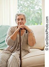 Senior woman with her walking stick
