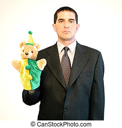 Serious-looking businessman holding a puppet.