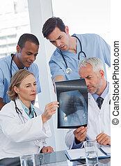 Serious medical team examining radiography