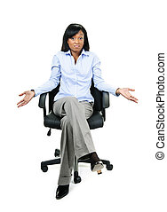 Shrugging businesswoman in office chair