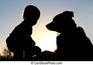 Silhouette of Child Playing with Dog