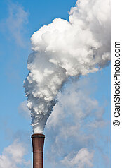 Smokestack with heavy pollution against the blue sky