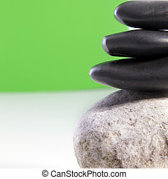 Smooth black spa stones