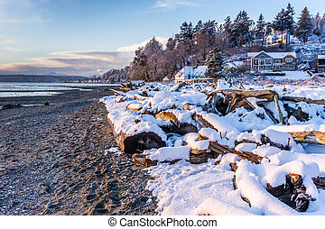 A view of snow along the shore in Normandy Park, Washington.