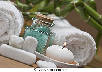 Spa background witn a candle and bath salts.