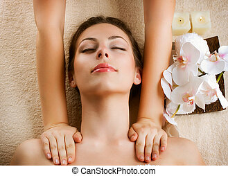 Spa Massage. Beauty Woman Getting Massage