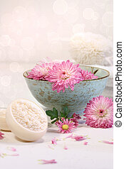 Spa scene with chrysanthemum flowers in water