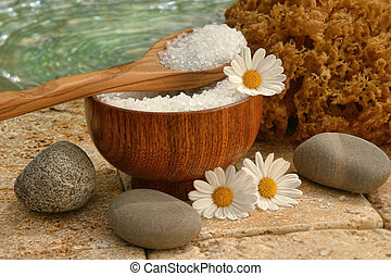 Spa still life with bath salts and daisies