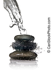 Spa stones with water splash isolated on white
