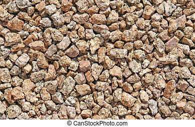 Close-up of brown and gray rocks speckled with granite. Shot with Canon 20D.