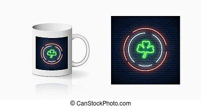 St Patricks Day neon glowing festive sign on ceramic mug mockup. Clover leaf sign on cup side. Green shamrock symbol