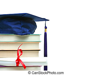 Stack of books with cap and diploma on white