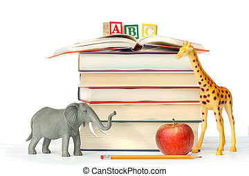 Stack of books with toy animals