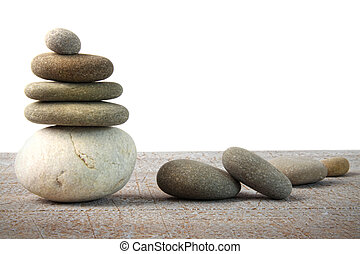Stack of spa rocks on wood on white