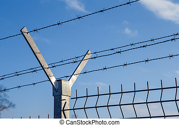Steel fence with barbed wire