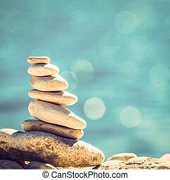 Stones balance, vintage pebbles stack background