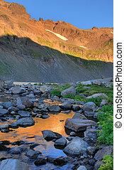 Sunrise light on cliffs, Goat Rocks Wilderness, Washington state.