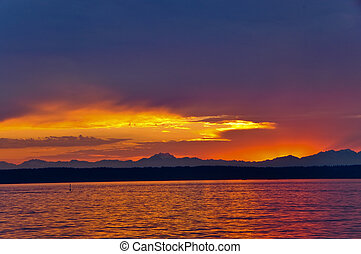 Beautiful sunset on Puget Sound, with the olympic mountains in the background